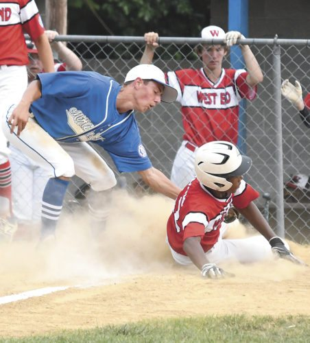 Sentinel photo by JEFF FISHBEIN  Colby Bodtorf (6) puts a tag on West End's Shaki Blacknell Thursday during the Babe Ruth 14-year-old state championship game. Blacknell scored on a wild pitch.