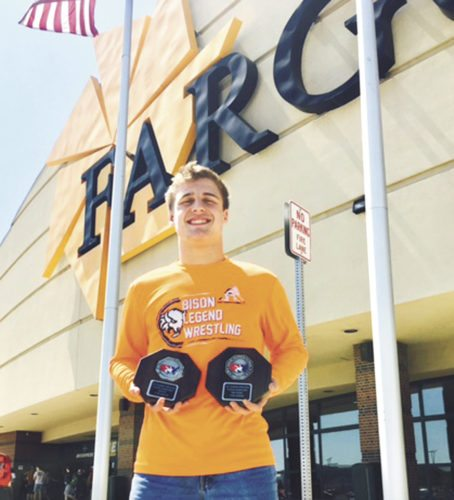 Photo submitted by MARK HIDLAY  Trent Hidlay poses with a pair of second-place trophies he earned at the Junior National Freestyle and Greco-Roman Wrestling tournament in Fargo, N.D.