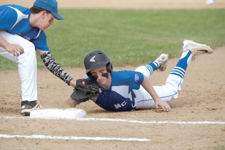 Sentinel photo by SCOTT LUSHER  Mifflin County's Seth Benson dives back to first base on Northern New Jersey's pickoff attempt, Wednesday afternoon in Niskayuna, N.Y. Mifflin County won its opener of the 15-year-old Babe Ruth Mid-Atlantic Regional tournament, 14-4.
