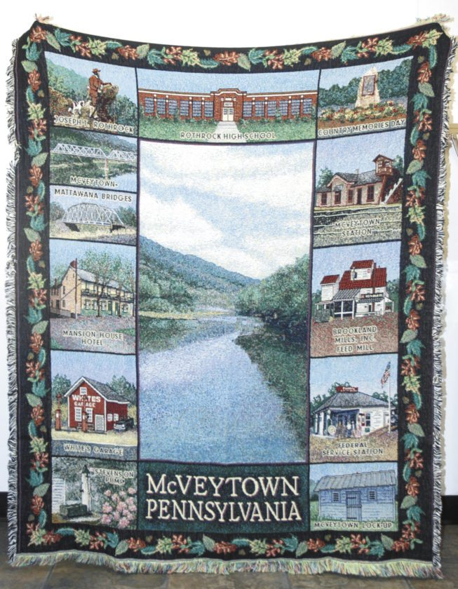 Sentinel photo by BUFFIE BOYER The McVeytown Country Memories Day Committee recently reordered the McVeytown keepsake throws that were sold several years ago, and made them available for sale once again.