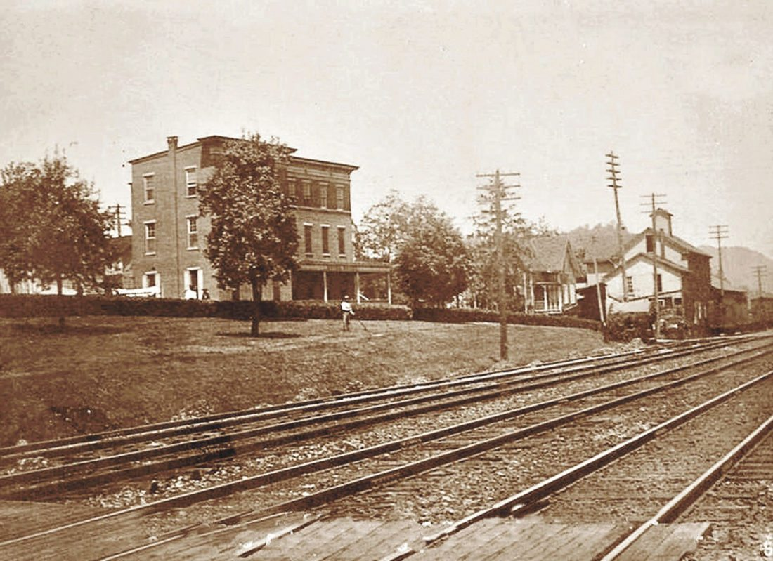 Photo submitted by WAYNE TAYLOR One of author Wayne Taylor's favorite photos of the Hotel Royal shows the grassy bank, which indicates that the photo was taken in 1906, before the construction of the East and West Stations. In his book, Taylor points out that the hotel was one of the businesses in the town that benefitted tremendously from the annual Juniata County Fair. 'Some people who traveled a distance to attend the fair would reserve rooms at the hotel because all Pennsylvania Railroad traffic disembarked almost on the front steps of the hotel. The rooms and dining area were filled to overflowing during the fair. The Hotel Royal was also a quieter place to obtain a nice meal, away from the hustle and bustle of the fairgrounds,' the book states. In addition, 'The Tuscarora Railroad unloaded most of its fair travelers at the Sixth Street entrance to the fairgrounds, although numerous men would continue to the end of the line right across from the Hotel Royal, where they could wet their whistle before taking in the sights and sounds of the fair.' The grassy area was said to be a gathering place for those men who may have not made it as far as the fairgrounds.