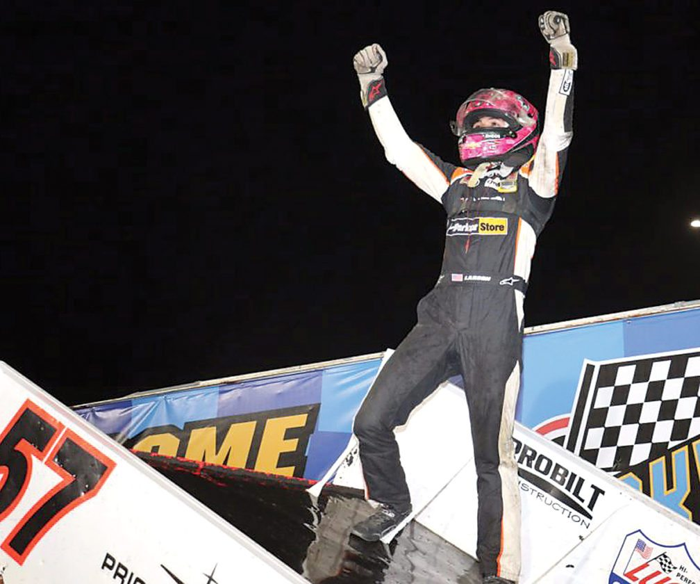 Sentinel photo submitted by DAVE BIRO III  Kyle Larson celebrates his victory at Knoxville Raceway, Wednesday, in Knoxville, Iowa. It was the opening night of the 57th annual Knoxville Nationals.