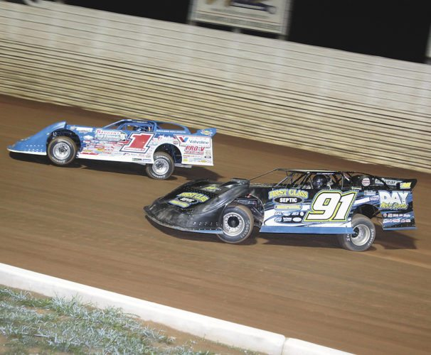Sentinel photo by TIM SHUMAKER  Brandon Sheppard (1) takes the lead over Tyler Erb in turn two of the World of Outlaws Late Model race Saturday evening in Port Royal. Sheppard won the shortened race, his 13th of the season.