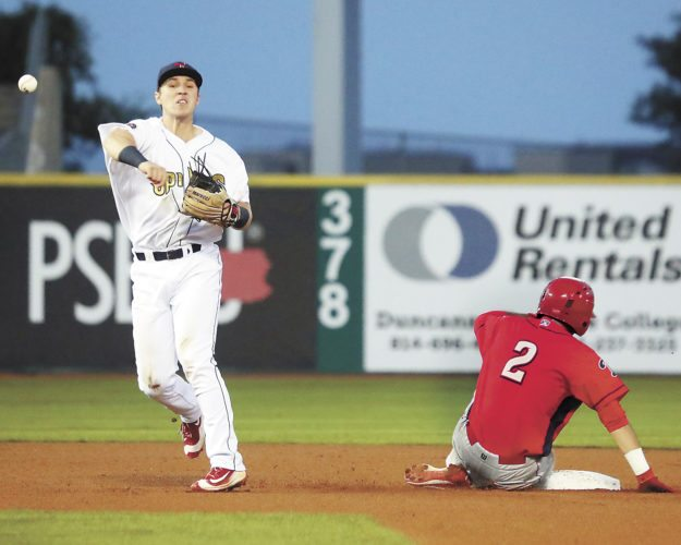 Sentinel photo by  CHRISTOPHERSHANNON  State College's Zach Kirtley turns two as Williamsport's Josh Stephen slides into second base during the Spikes' 3-1 SawBuck Series victory over the Crosscutters Saturday evening in State College.