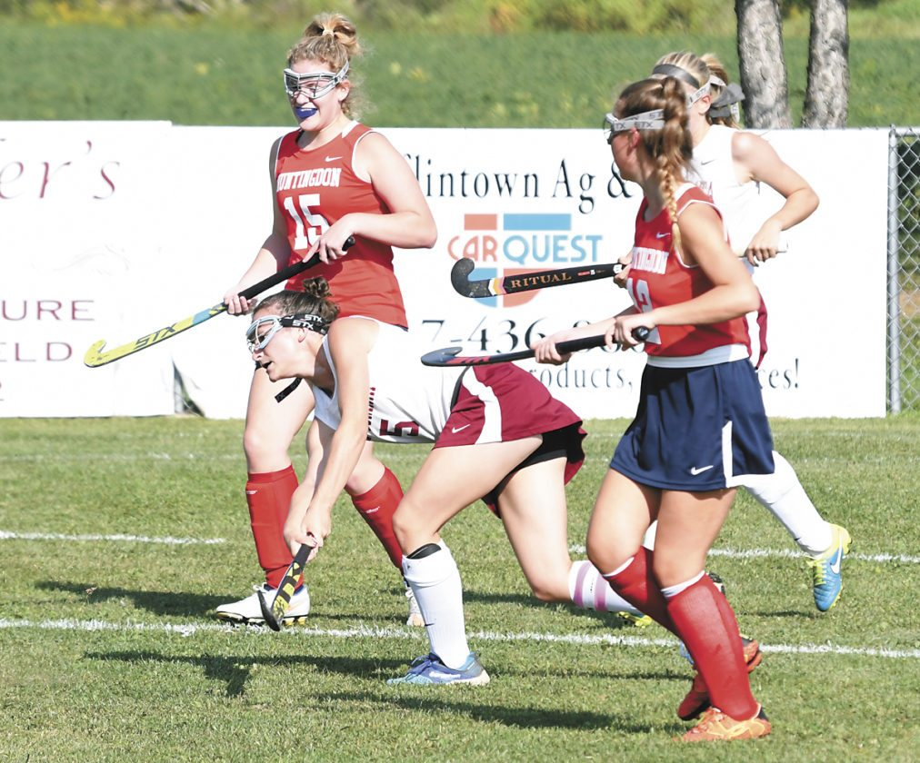Sentinel photo by JEFFFISHBEIN  East Juniata's Emily Knepp, center, runs the ball down the field as Huntingdon's Reagan Querry, 15, and Sarah Farley, 12, and East Juniata's Kyli Dowling, 4, run with her Monday in Cocolamus.