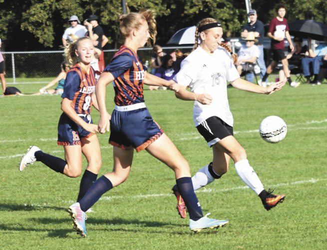 Sentinel photo by JEFF FISHBEIN  Mifflin County's Jessica Bickhart, right, leads Hershey's Olivia Bratton (8) and Claudia Zugay down the field during their Mid-Penn Keystone girls soccer game Tuesday in Lewistown.