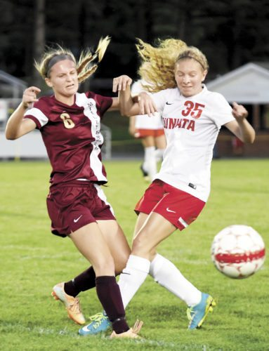 Sentinel photo by BUFFIE BOYER  Millersburg's Jillian Cougle, left, and Juniata's Nylah Pannebaker collide during a Tri-Valley League girls soccer game, Wednesday, at Dietrick Field. Juniata won, 4-0.