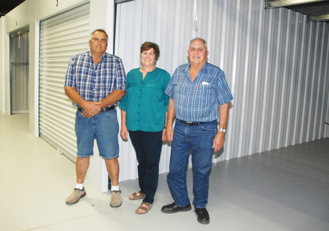 Sentinel photo by BUFFIE BOYER Members of the Long family, from left, Kevin, Teresa (Long) O'Neal and Larry Long, are bringing 28 years of experience in the storage unit business to Mifflin County at their new location, Orchard Hills Storage along Ferguson Valley Road in Burnham.