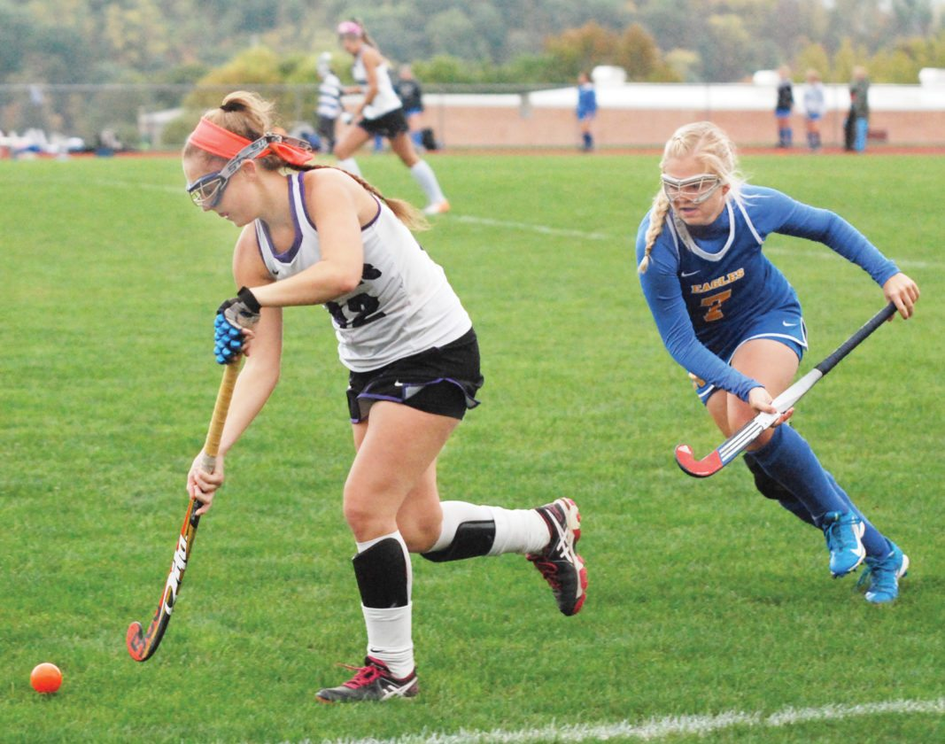 Sentinel photo by BRADLEY KREITZER  Mifflin County's Daphne Snook, left, moves the ball down field after taking it away from Line Mountain's Caitlin Keim Thursday afternoon at Highland Park.