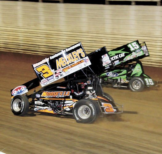 Sentinel photo by TIM SHUMAKER  Brock Zearfoss (3) and Donny Schatz (15) race around turn two during the World of Outlaws Craftsman Spring Car Series race Saturday at Port Royal Speedway.