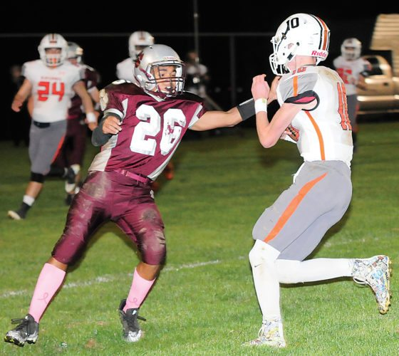 Sentinel photo by MATT STRICKER  East Juniata's Kameron Kline, left, looks to make a stop on Susquenita quarteback Chance Hare during their game Friday in Beaver Springs.