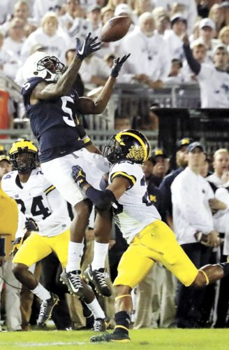 Sentinel photo by CHRISTOPHER SHANNON Penn State's DaeSean Hamilton (5) makes a catch between Michigan's Lavert Hill and Tyree Kinnel during the Nittany Lions' 42-13 victory over the Wolverines Saturday evening in University Park.
