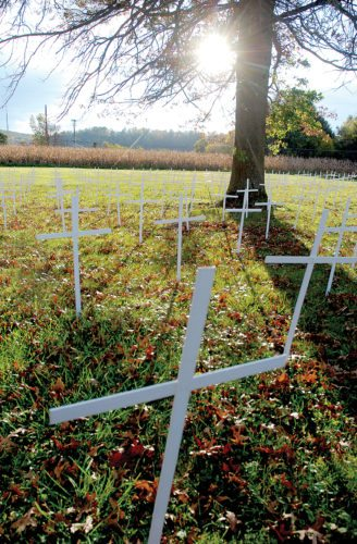 Sentinel photo by BUFFIE BOYER A display of 525 crosses on the lawn at St. Jude Thaddeus Catholic Church in Mifflintown represent the lives lost to abortion over a five-day period in Pennsylvania.