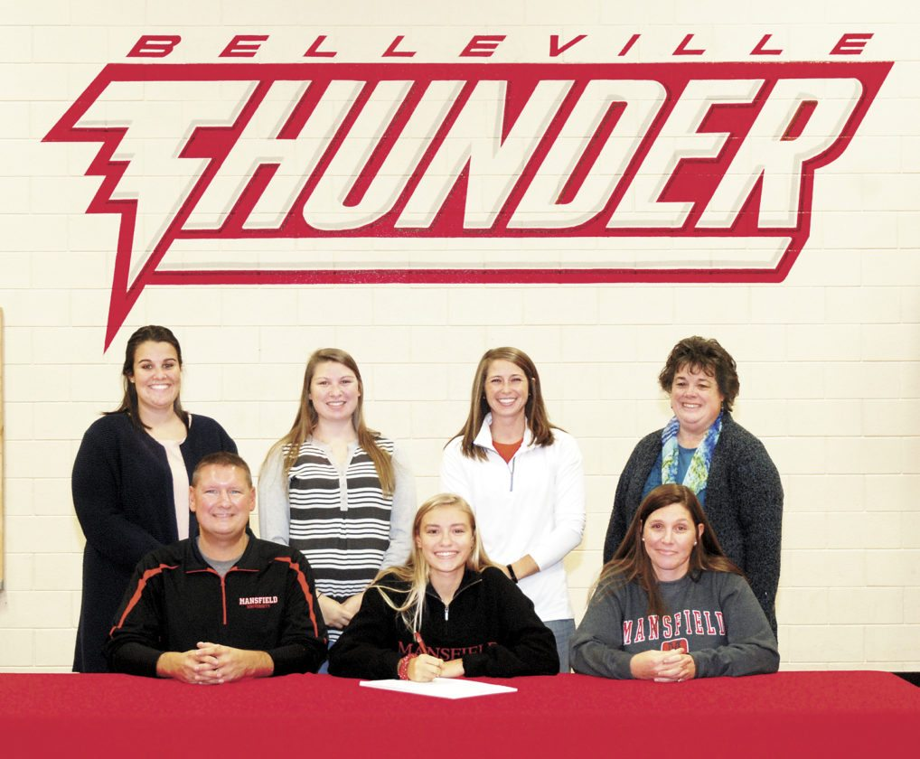 Sentinel photo by BUFFIEBOYER  Belleville Mennonite School senior Olivia Bell, front center, signed her letter of intent Wednesday to play field hockey at Mansfield University. Joining Bell are, from left, front, parents Steve and Kristel; back, Chelsea Sarra, Huntingdon High School field hockey coach; Kaitlin Byler, Bell's sister; Steph Hoffman, BMS athletic director; and Starla Fogelman, BMS superintendent. Byler and Bell were part of BMS' 2016 District 6 championship team.