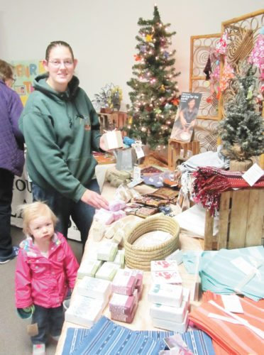 Submitted photo Destiny Moyer and her daughter browse the merchandise at the 2016 Juniata Valley International Gifts Sale.