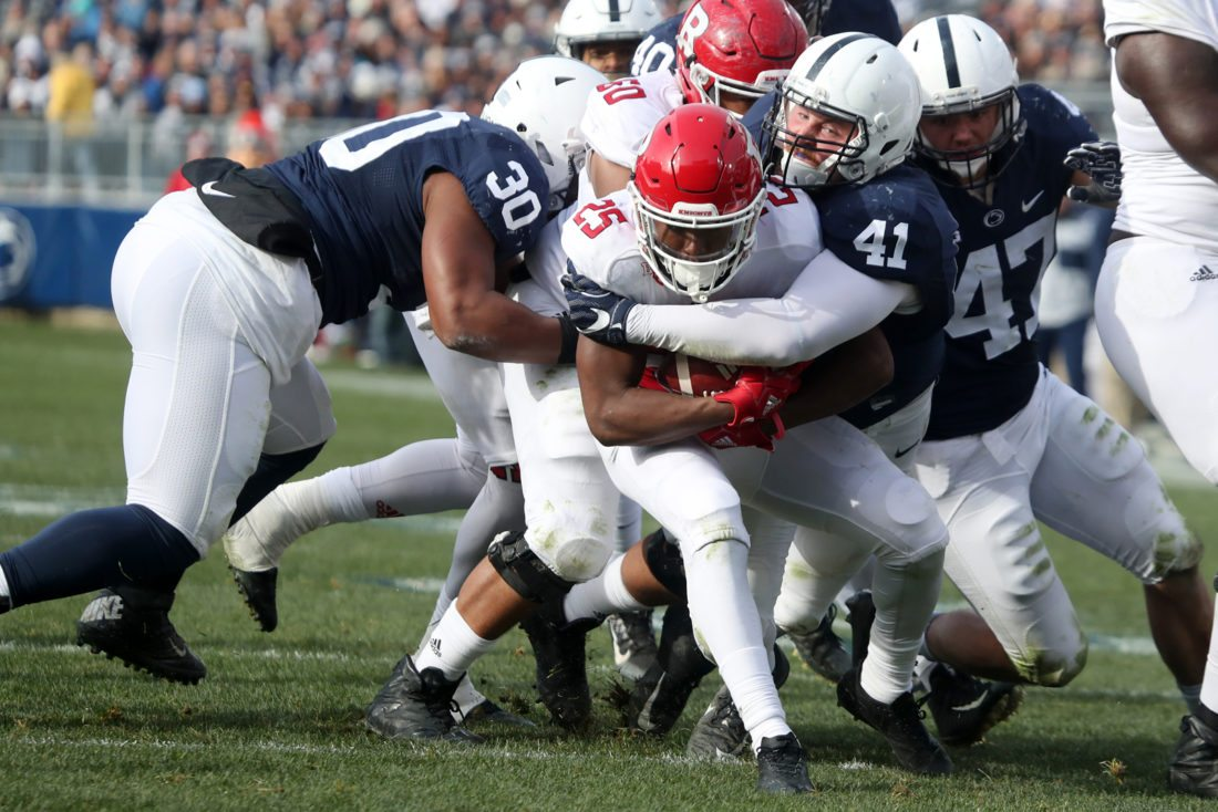 Sentinel photo by CHRISTOPHERSHANNON Penn State's Parker Cothren (41) tackles Rutgers' Raheem Blackshear during the Nittany Lions' 35-6 victory over the Scarlet Knights Saturday afternoon at Beaver Stadium.