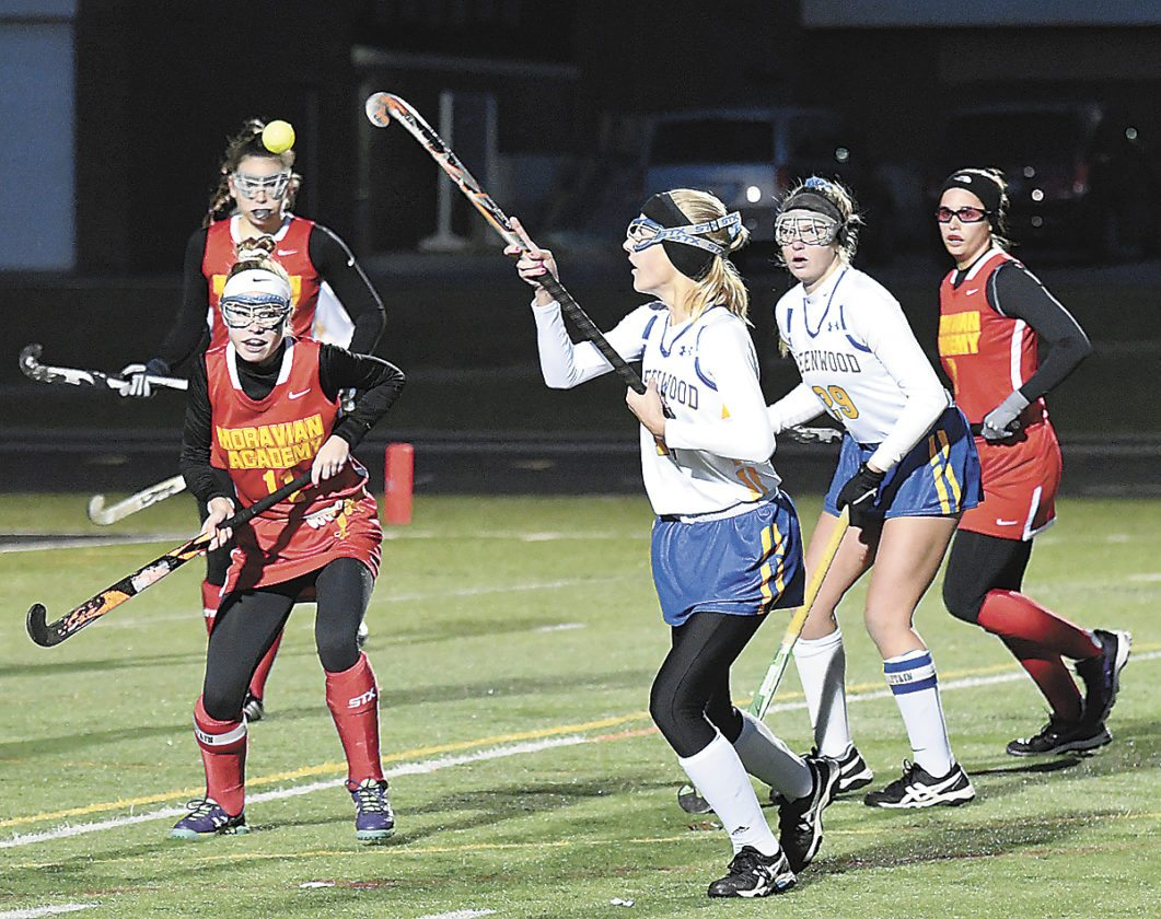 Sentinel photo by JEFFFISHBEIN Greenwood's Leah Bryner, third from right, knocks down a ball in front of Moravian's Ellie Werner during their PIAAClass A field hockey quarterfinal at Warwick Saturday. Behind Bryner is teammate Paityn Wirth and Moravian's Kate Costantino.