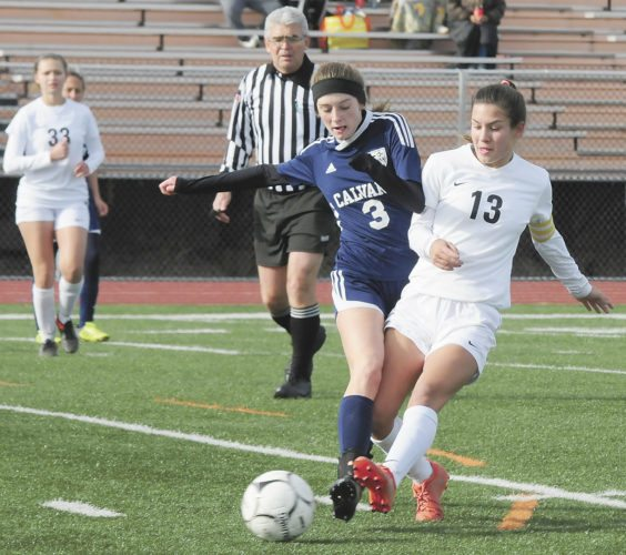 Sentinel file photo  East Juniata's Eleana Benner tangles with aCalvary Christian player for a ball in a state quarterfinal game.