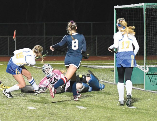 Sentinel photo by JEFF FISHBEIN  Greenwood's Paityn Wirth (29) is blocked on a shot attempt by Newport goalie Tristan Britcher in front of Newport's Sophia Bianchi (8) and Greenwood's Hailey Womer in their PIAA Class A field hockey semifinal Tuesday at West Perry.