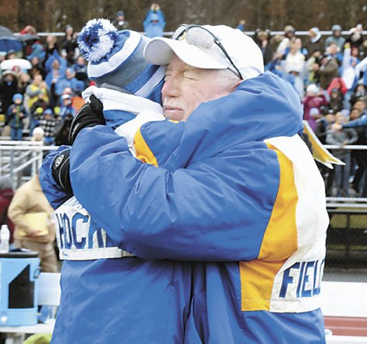 Sentinel photo by BUFFIE BOYER  Greewood coach Kent Houser, right, and assistant Kate Gantt embrace after the Wildcats won the state championship game.