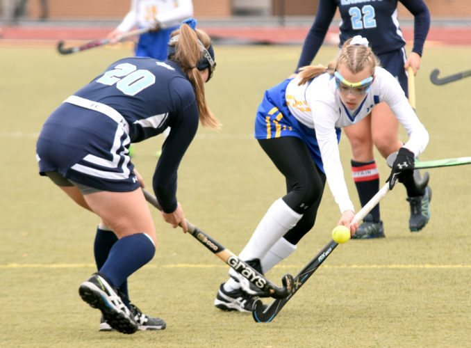 Sentinel photos by BUFFIE BOYER  Greenwood's Cori Davis, right, moves a ball past Wyoming Seminary's Emily Sims during Saturday's PIAA Class A field hockey championship game at Whitehall.