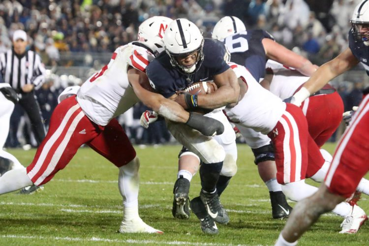 Sentinel photo by CHRISTOPHER SHANNON  Penn State's Saquon Barkley runs between two Nebraska defenders during the Nittany Lions' 56-44 victory over the Cornhuskers Saturday evening in Beaver Stadium.