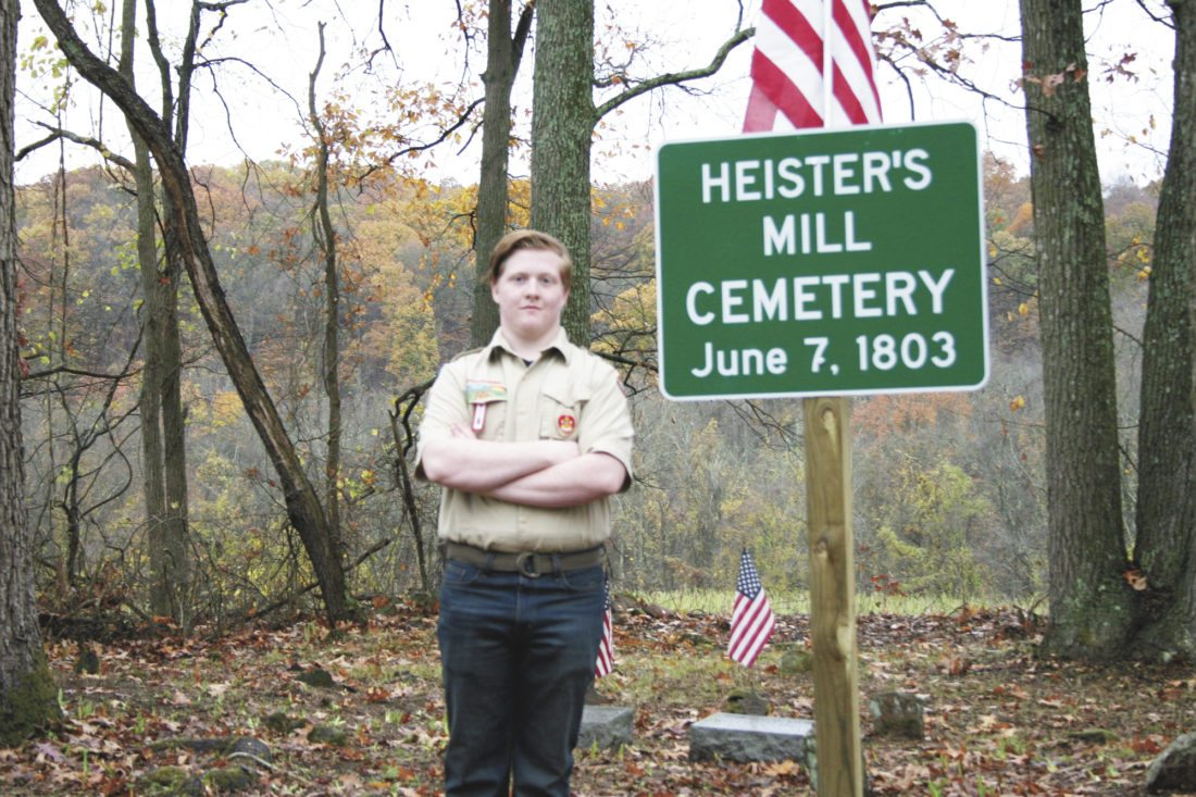 Photo submitted by Bill Sieber Kyler Sieber, 17, a Boy Scout with Troop 76 in Mount Union, recently completed his Eagle Scout project. His project was cleaning up the Heister's Mill cemetery along Little Greenbriar Road in Wayne Township. The cemetery was very overgrown and needed a lot work to enable people to visit and read the gravestones. Brush was removed, trash cleaned up and grass seed was put down. A sign was erected with the name of the cemetery and the date it was created. There are five known graves, including three veterans interred in the cemetery: James Glasgow, William Latherow, Reuben Niece (Mexican American War vet) Willis Copelin (Mexican American War vet) and John Graham (Revolutionary War vet). A ceremony was held on Nov. 5 dedicating the cemetery.