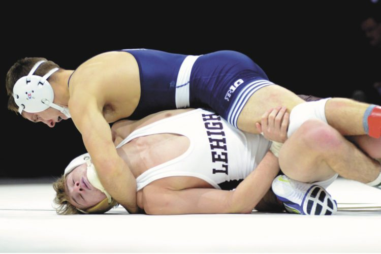 Sentinel photo by FRANK DIMON  Penn State's Zain Retherford, top, pressures Lehigh's Cortlandt Schuyler at 149 pounds Sunday afternoon at the PPL Center in Allentown. Retherford picked up the fall in 1:27.
