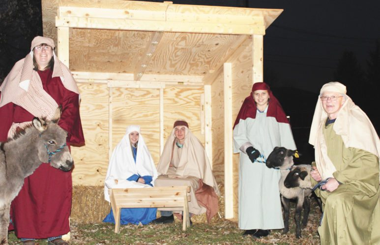 Sentinel photo by TABITHA GOODLING Volunteers with McAlisterville United Methodist Church presented a live Nativity scene during the first weekend of December outside the church building. Pictured, from left, are Sally Harshberger, Chloe Dressler, Nathan Lower, Greg Fosselman and Alexia Berry. Live Nativity scenes are also scheduled to be held from 6 to 10 p.m. Dec. 15 and 16 at Middlecreek Farms, 134 Farmhaus Lane, Middleburg; and from 5:30 to 8:30 p.m. Dec. 22 and 23 at Kish Park.