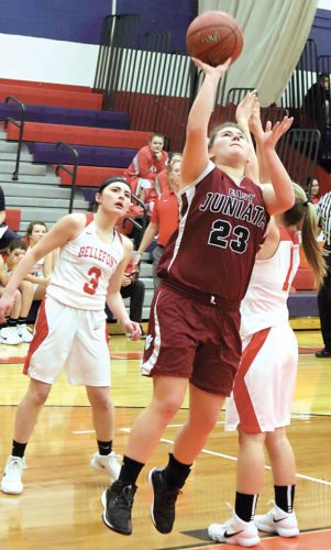 Sentinel photo by MATT STRICKER East Juniata's Lily Sankey (23) attempts a shot between Bellefonte defenders Abbey Bruni, left, and Maddie Steiner Friday in Mifflintown.