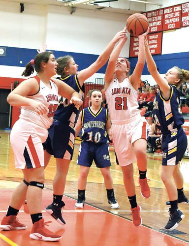 Sentinel photo by MATT STRICKER Juniata's Chloe Zendt attempts to muscle a shot through Southern Huntingdon defenders McKenzie Yohn, Raven Booher, right, and Hannah Booher (10) Friday in Mifflintown. Also in the play is Juniata's Malin Kint, left.