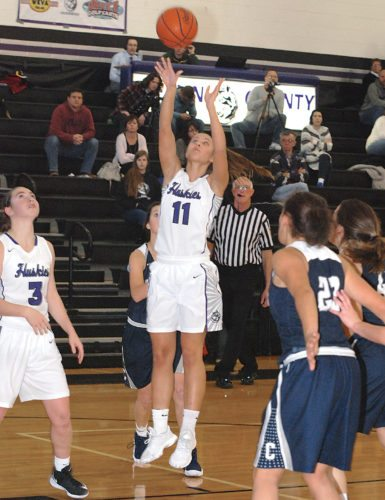 Sentinel photo by BRADLEY KREITZER  Mifflin County's Jenna Fleegal (11) takes a shot in the second quarter against Chambersburg Tuesday evening in Lewistown.