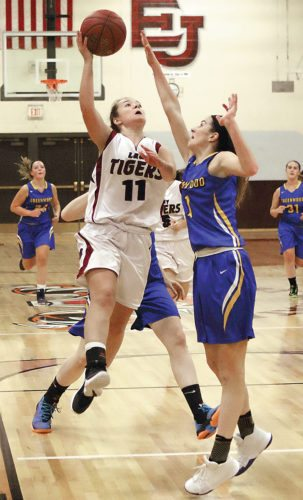 Sentinel photo by MATTSTRICKER  East Juniata's Clarye Guyer, left, goes to the board against Greenwood defender Kenedy Stroup Tuesday in Cocolamus.
