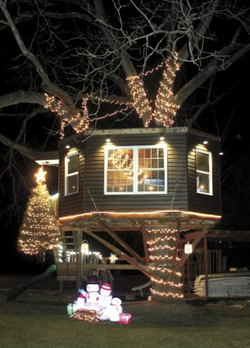 Sentinel photo by LAUREN KERSHNER Christmas lights adorn a treehouse built by Matt Deamer, of Burnham. The structure is fully furnished with plumbing and insulation. Deamer said he was inspired by the television series 'Treehouse Masters' and built the structure for his children.