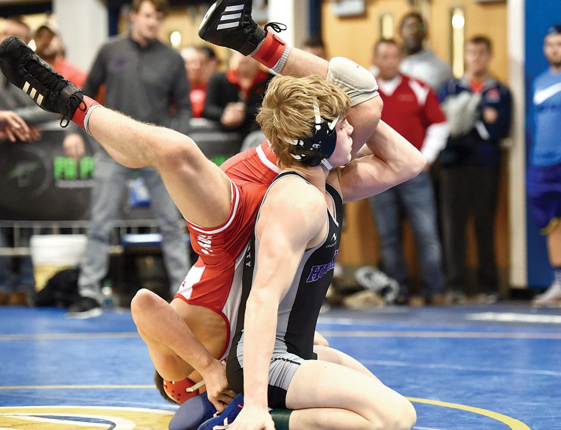 Sentinel photo by MARC BILLET/Tri-State Sports &News Service Mifflin County's Trey Kibe, an unseeded freshman, advances to the 152-pound semifinals with a 10-6 win over Cooper Kropman of Pennfield, New York, in the quarterfinals of the Powerade Christmas Tournament Friday at Canon-McMillan.