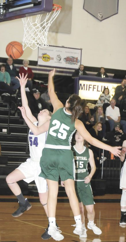 Sentinel photo by TIMSHUMAKER Mifflin County's Emma Yeager (54)goes up for a shot while Central Dauphin's Nadia Romanchock (25)blocks during their Mid-Penn Comonwealth girls basketball game Friday in Lewistown.