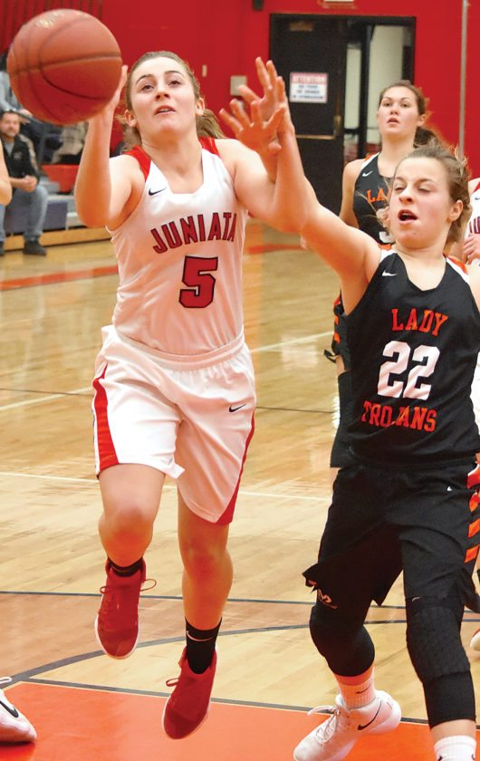 Sentinel photo by MIKEGOSS  Juniata's Josie Swartz (5) is fouled by Upper Dauphin's Olivia Halterman as she drives the lane in Thursday's Tri-Valley League girls basketball game in Mifflintown.