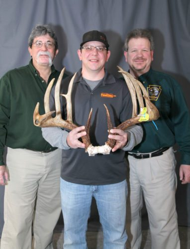 Pa. Game Commission photo  Ron Shaulis, center, holds his record-breaking typical whitetail deer rack taken with a compound bow on Oct. 24, 2017. He is with official Boone and Crockett Club scorer Ray Brugler, left, and Game Commission Big-Game Scoring Program Coordinator and official B&C Club scorer Bob D'Angelo.