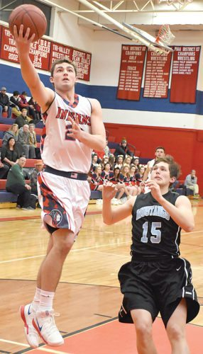 Sentinel photo by MIKE GOSS Juniata's Ben Lauver (23) drives to the basket against Midd-West's Sam Brummett Thursday in Mifflintown.