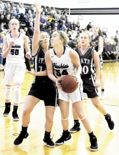 Sentinel photo BUFFIE BOYER  Mifflin County's Emma Yeager, 54, looks for two points, as State College's Isabelle Leazier attempts to block Friday in Lewistown. Mifflin County's Molly Wagoner, 50, and State College's Jessica Lingenfelter look on.
