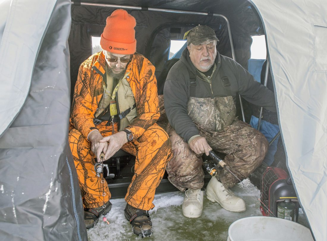AP photo Dan Yurich and Dan Kovolenko, both of Hopewell, sit in their ice hut on the Sheango River Lake near the Golden Run Wildlife Area in Clark as they fish on 8 to 10 inches of ice. The two of them have safety gear including life vests, ice picks, warm clothing and ice cleats for their boots.