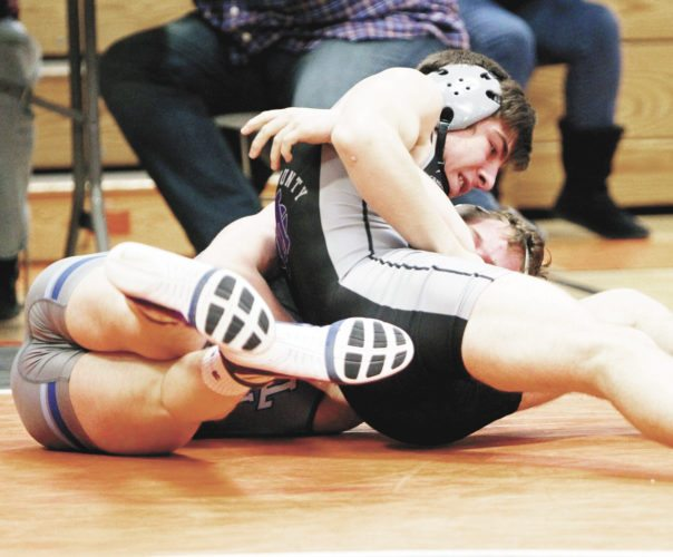 Sentinel photo by JAY WHITESEL Mifflin County's John Retherford turns Lane Porter of Central Mountain on the way to a match-tying pin that allowed the Huskies to advance to the District 6 Class 3A team wrestling final.