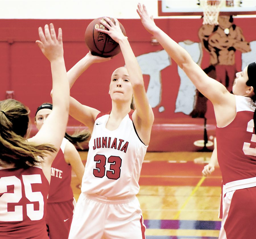 Sentinel photo by MIKEGOSS  Juniata's Olivia Clark, 33, scores over Bellefonte defenders Hannah Lauck, 25, and Abbey Bruni Saturday in Mifflintown.