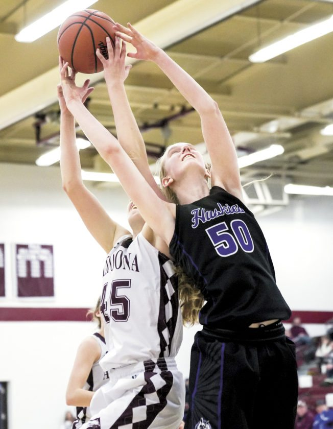 Sentinel photo by CHUCK MEYERS  Mifflin County's Molly Wagoner, right, fights for the rebound against Altoona's Bridgid Fox Saturday in Altoona. Altoona won the game, 53-49.
