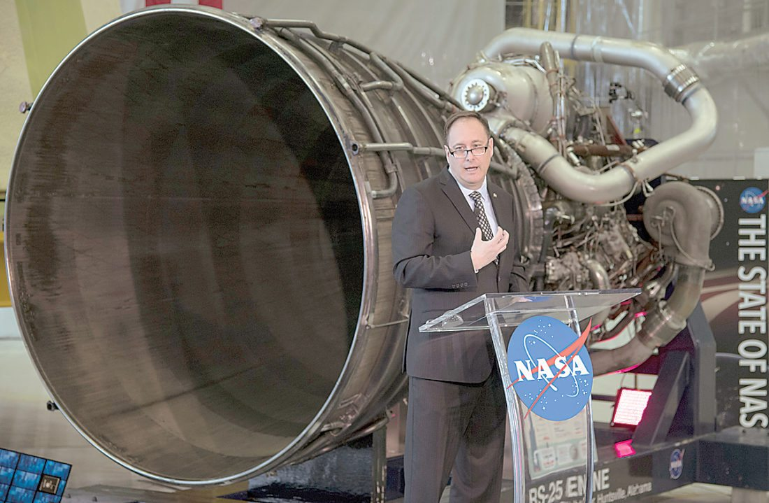 In his image provided by NASA, acting NASA Administrator Robert Lightfoot discusses the fiscal year 2019 budget proposal during a State of NASA address, Monday, Feb. 12, 2018, at NASA's Marshall Space Flight Center in Huntsville, Ala. (Bill Ingalls/NASA via AP)