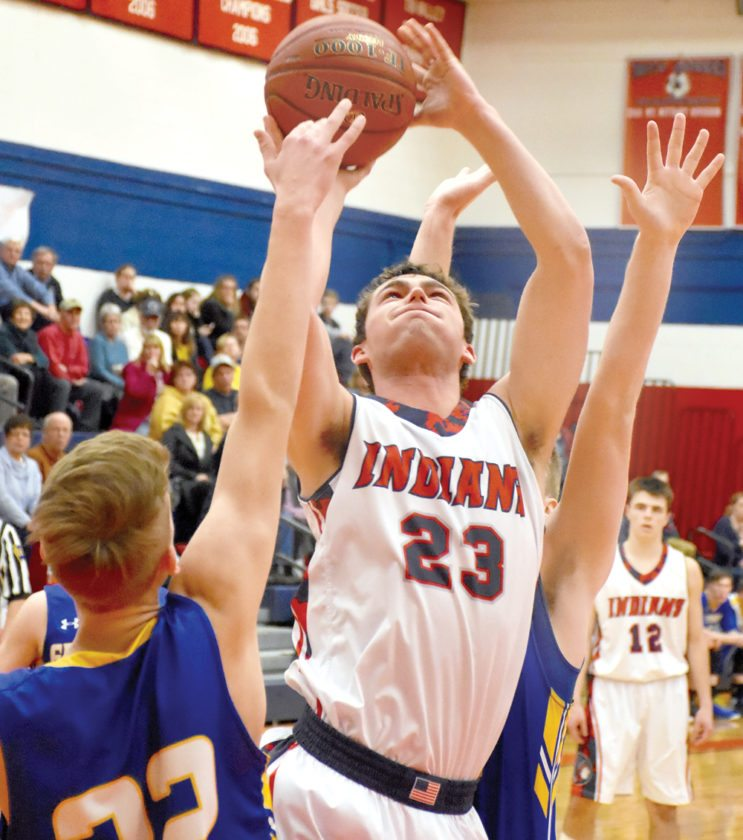 Sentinel photo by MIKEGOSS Juniata's Ben Lauver (23) scores against Greenwood's Aaron Bollinger, left, in their Tri-Valley League boys basketball semifinal Tuesday. Lauver scored his 1,000th point in the game.