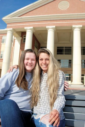 Sentinel photo by BUFFIE BOYER Taylor Seachrist, left, and Marcella Pupo, both seniors at Mifflin County High School, are planning a Winter Special Olympics event at the school in March. A spaghetti dinner is being held on Feb. 21 to raise money for the event.