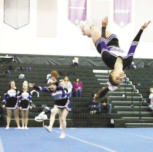 Sentinel photo by MATT STRICKERKiana Sechler, right, flips during the Mifflin County competitive spirit squad's performance in the Winter Cheer Explosion held Saturday in Lewistown.