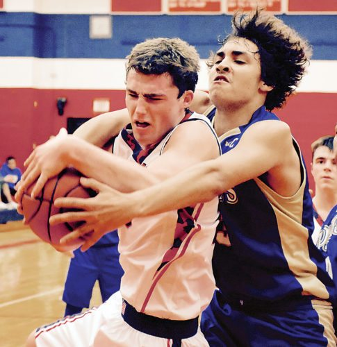 Sentinel photo by MIKE GOSS  Juniata's Ben Lauver, left, and Mount Union's Tyreki Seacrest fight for a rebound Wednesday.
