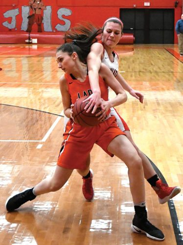 Sentinel photo by JEFF FISHBEIN  Juniata's Ellie Shepps, right, reaches for the ball against Tyrone's Lindsay Fusco in their District 6 Class 3A girls basketball playoff game Friday in Mifflintown.